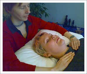 Giving a Reiki treatment to another